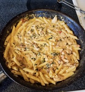 Chicken Bacon pasta with tomato Parmesan sauce